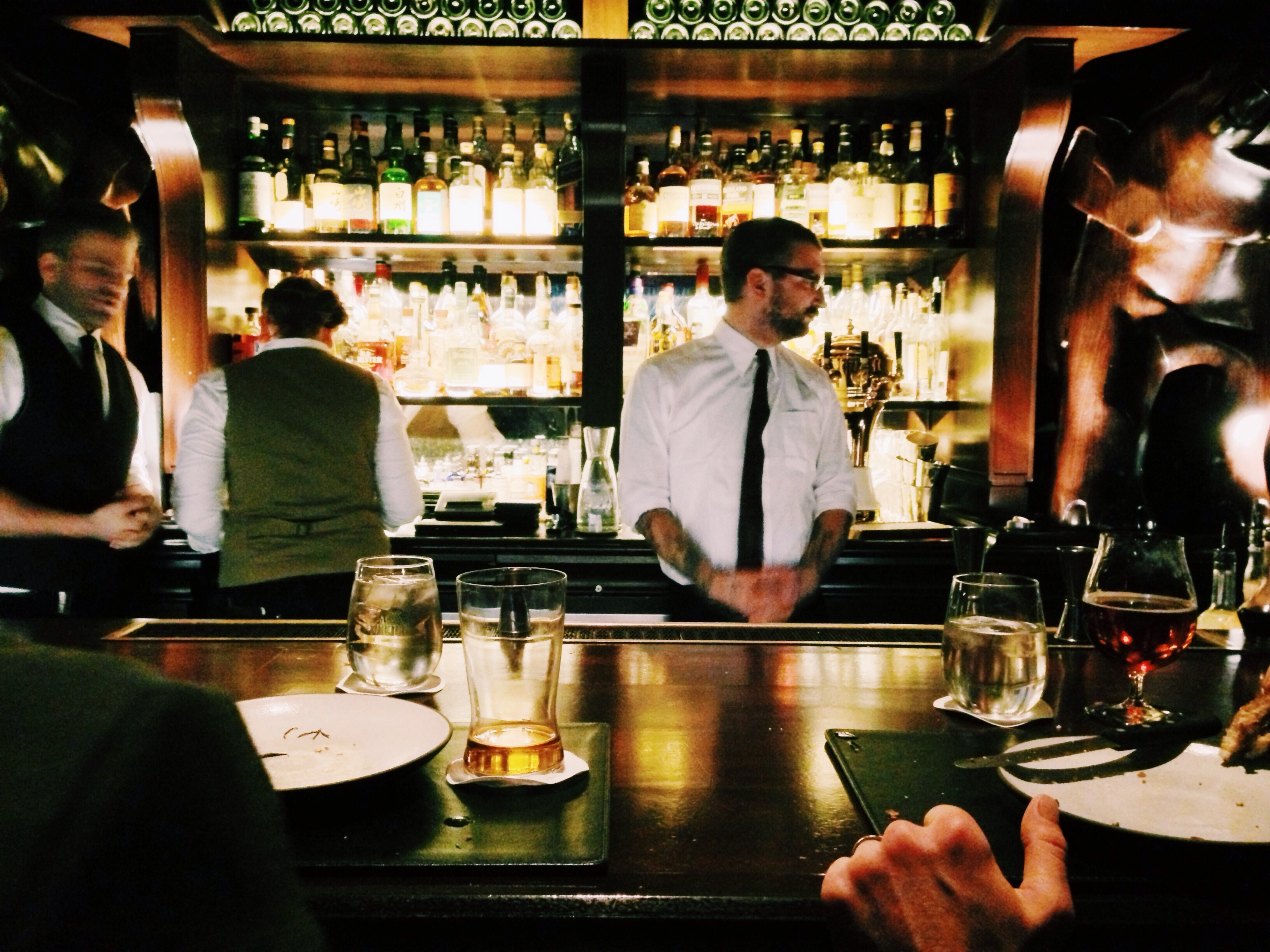 It is rush-hour, and your workplace is buzzing. You have to place drink orders at the bar, for the bartenders that have their hands full on the other side of the bar. How are you going to get your orders to the bartender?